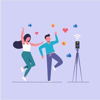 Videoblogger, mannelijke en vrouwelijke dansende livestreaming met smartphone, vlakke karakterillustratie.