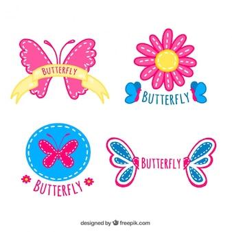Vier badges met vlinders