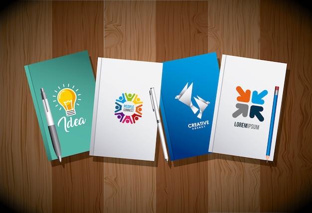 Vier dagboek en pennen huisstijlsjabloon reclamebusiness