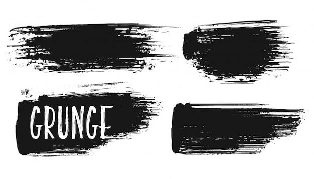 Vier handgeschilderde grunge penseelstreken instellen