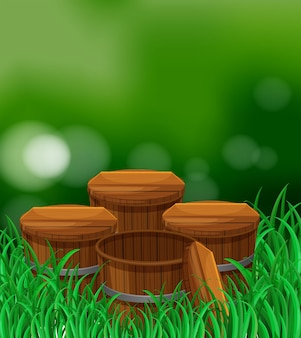 Vier houten emmers in de tuin