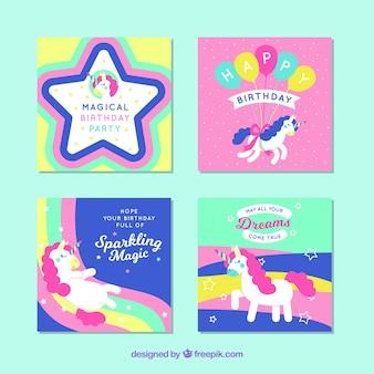 Vier kleurrijke verjaardagskaarten met eenhoorns