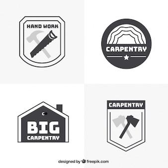 Vier logo's voor timmerwerk, zwart en wit