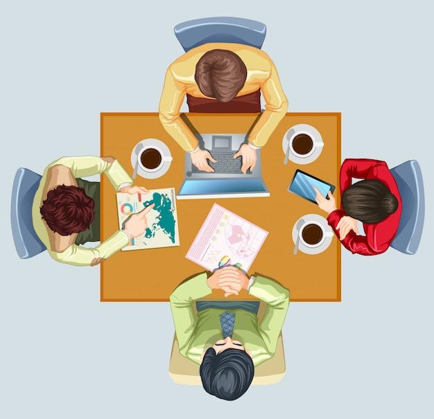 Vier mensen die een ontmoeting hebben aan de tafel