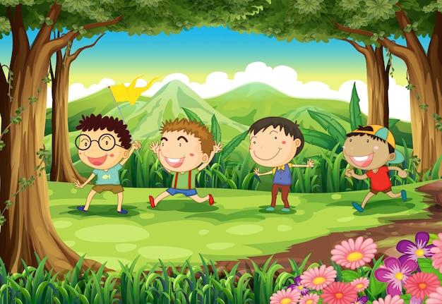 Vier speelse kinderen in het bos