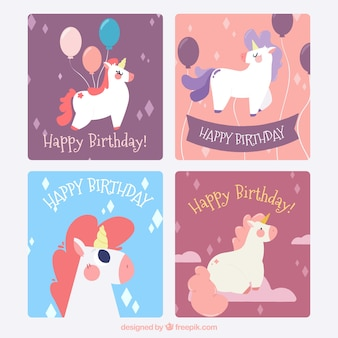 Vier verjaardagskaarten met grappige eenhoorns