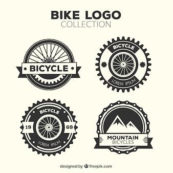 Vier vintage fietslogo's