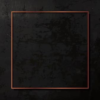 Vierkant koperen frame op zwarte achtergrond