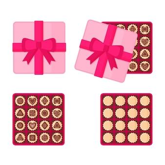 Vierkante roze doos chocolaatjes.