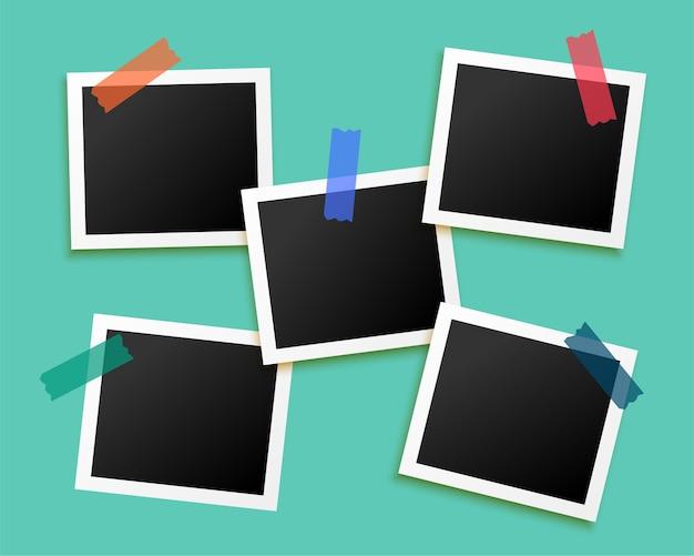 Vijf fotolijsten geplakt door tape achtergrond