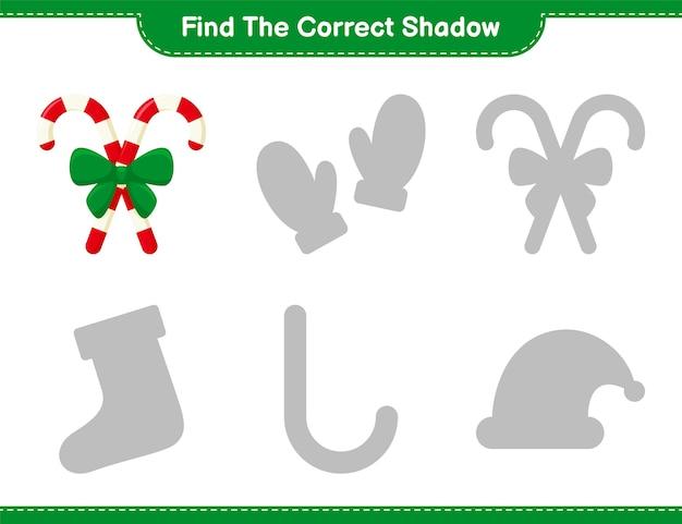Vind de juiste schaduw. zoek en match de juiste schaduw van candy canes met ribbon. educatief kinderspel