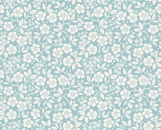 Vintage bloemmotief in kleine witte bloemen naadloze printfor fashion print blauwe achtergrond