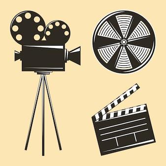 Vintage camerastatief en filmstrip-clapperboard