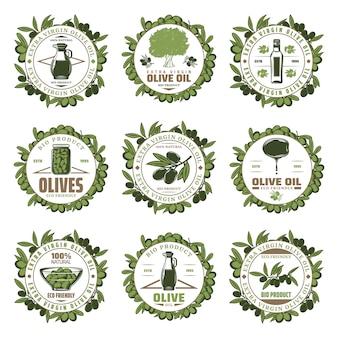 Vintage gekleurde olijf emblemen set met inscripties boomtakken potten fles extra vierge olijfolieproducten geïsoleerd