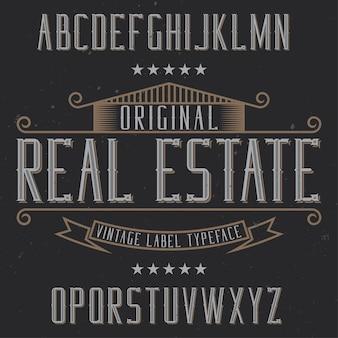 Vintage label lettertype met de naam onroerend goed. goed lettertype om te gebruiken in vintage labels of logo.