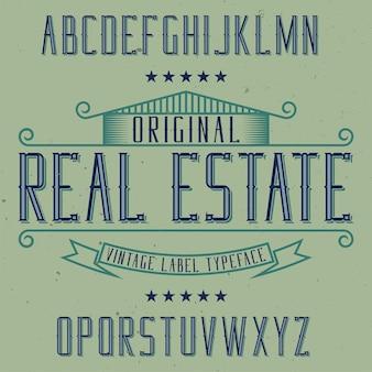 Vintage label lettertype met de naam onroerend goed