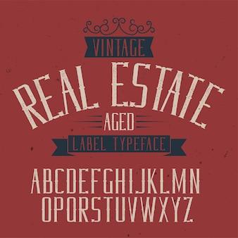 Vintage label lettertype met de naam onroerend goed.