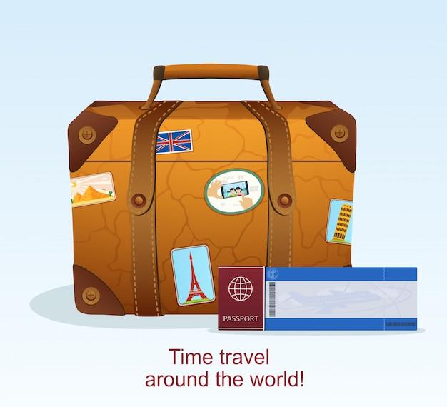 Vintage lederen koffer met reissticker, ticket met een paspoort om te reizen
