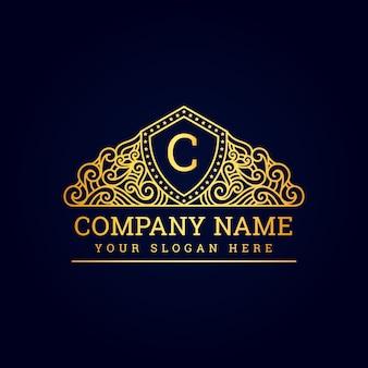 Vintage luxe koninklijk premium logo met gouden
