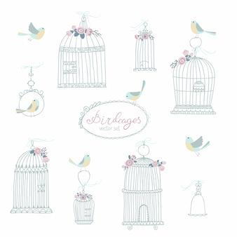 Vintage set voor decoratieve vogelkooien. versierd met bloemen. zittende en vliegende vogels. illustratie in vrije hand getrokken stijl in pastelkleuren