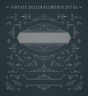 Vintage vignetten wervelingen ornamenten decoraties ontwerpelementen ingesteld op schoolbord