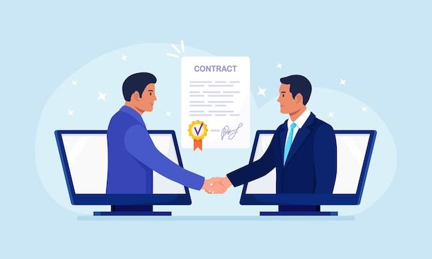 Virtuele deal met overeenkomst op afstand. zakenlieden praten via de computer en schudden elkaar de hand. online communicatie en zakelijke bijeenkomst, videogesprek. afsluiten van de transactie op afstand, ondertekening contract