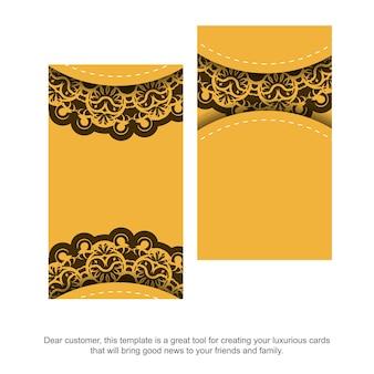 Visitekaartje in geel met indiase bruine ornamenten voor uw bedrijf.