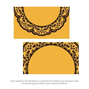 Visitekaartje in gele kleur met vintage bruin patroon voor uw contacten.