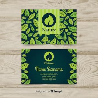 Visitekaartje met bladeren ontwerp