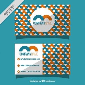 Visitekaartje met oranje en blauwe geometrische vormen