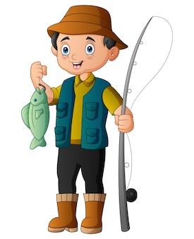Vissers in rubberen laarzen met een gevangen vis en een hengel