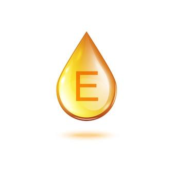 Vitamine e gouden oliedruppel - realistische druppelvorm van gouden vloeistof met gloeiende glanzende textuur. gezond supplement