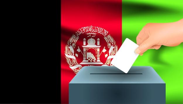 Vlag van afghanistan een mannenhand stemmen met de vlag van afghanistan achtergrond
