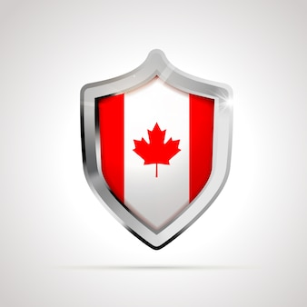 Vlag van canada geprojecteerd als een glanzend schild geïsoleerd