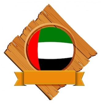 Vlag van de verenigde arabische emiraten op ronde badge met banner