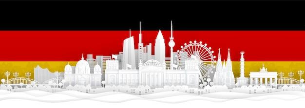 Vlag van duitsland en beroemde bezienswaardigheden in papier knippen stijl vectorillustratie.
