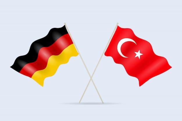 Vlag van duitsland en turkije samen. een symbool van vriendschap en samenwerking van staten.