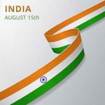 Vlag van india. 15 augustus. blauw ashoka-wiel. chakra. vector illustratie. golvend lint op grijze achtergrond. onafhankelijkheidsdag. nationaal symbool.