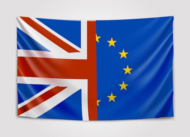 Vlaggen van het verenigd koninkrijk en europa die in verschillende richtingen bewegen. referendum over lidmaatschap van de europese unie in het verenigd koninkrijk. brexit.