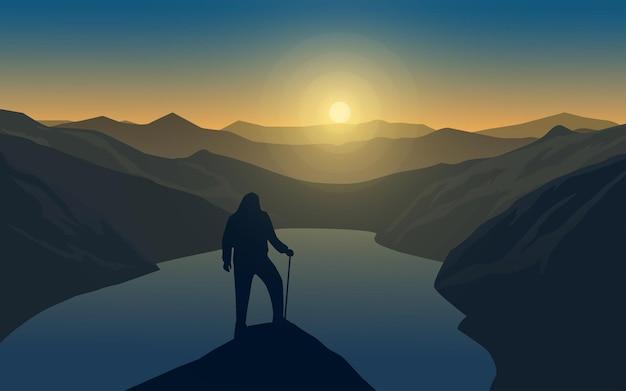 Vlak landschap met eenzame reiziger bovenop de berg