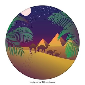 Vlak nachtlandschap met egyptische piramides en caravan van kamelen