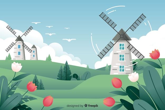 Vlak natuurlijk landschap met molens