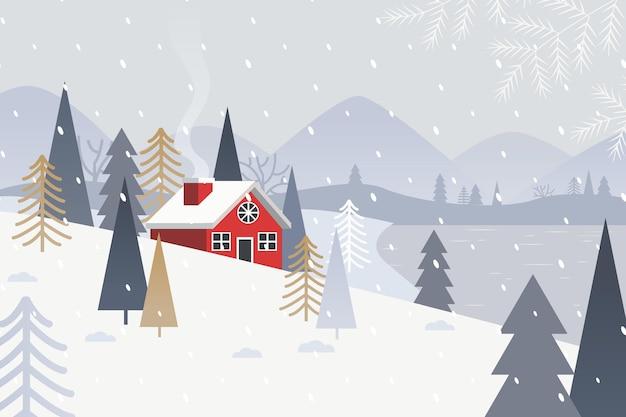 Vlak winterlandschap met dorp