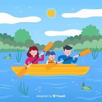 Vlakke familie die van de zomervakantie geniet