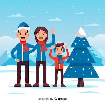 Vlakke golvende familie buiten kerstmisachtergrond