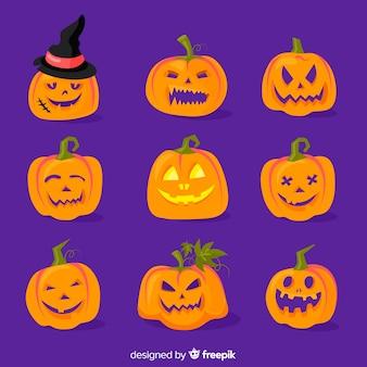 Vlakke halloween-pompoeninzameling op blauwe achtergrond