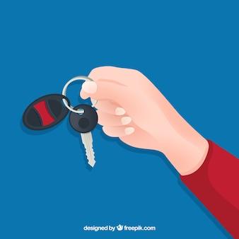 Vlakke hand met auto sleutel achtergrond