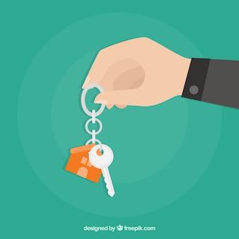 Vlakke hand met huis sleutel achtergrond
