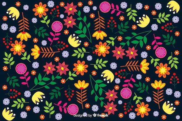 Vlakke kleurrijke bloemen en bladerenachtergrond