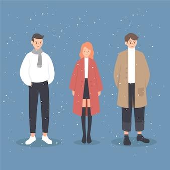 Vlakke mensen die winterkleren dragen